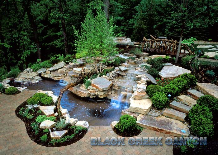 Custom Pools By Design relaxing omni custom pool design with raised circle jacuzzi in modern home patio Custom Pools And Waterfalls By Black Ckeek Canyon